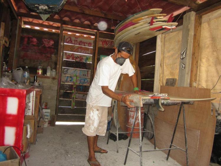 Héctor in his repair shop